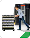 Illustration of a worker pushing a tray of servers