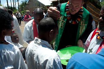 Photo: Rev. John Mehl baptizing a boy in Papua New Guinea.