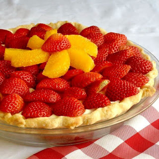 White Chocolate Mousse Pie with Orange and Strawberry.