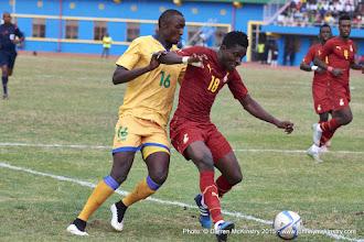 Photo: Daniel Amartey (18) closes out an attack from Ernest Sugira (16) [Rwanda Vs Ghana AFCON2017 Qualifier, 5 Sep 2015 in Kigali, Rwanda.  Photo © Darren McKinstry 2015