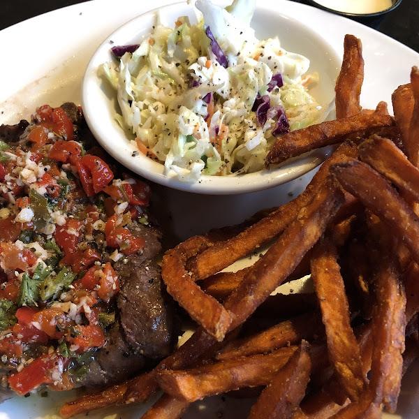 Chimichurri steak with sweet potato fries and house slaw