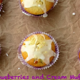 Blueberries and Cream Muffins with Lemon Glaze.
