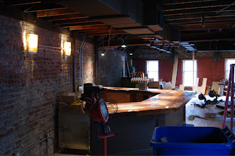 Photo: View of the second floor bar from the rear of the property