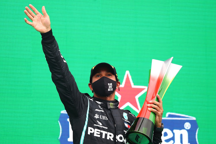 Race winner Lewis Hamilton of Great Britain and Mercedes GP celebrates his record breaking 92nd race win on the podium during the F1 Grand Prix of Portugal at Autodromo Internacional do Algarve in Portimao, Portugal, October 25 2020. Picture: JOE PORLOCK/GETTY IMAGES