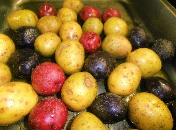 Preheat oven to 350 degrees.  In an oven proof roasting pan, add potatoes,...