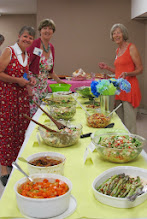 Photo: Grannies Kathy, Sue H and Barb are doing the last minute check of the incredible potluck donations - Sharing the Salad Bowl