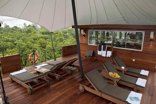 Aria-deck-2 - Relax in a premium lounge chair on Aria's Observation Lounge and watch the northern Amazon glide by.