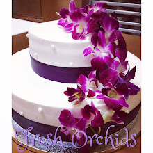 Photo: Cascading Orchid Wedding Cake featuring purple ribbon wrap, no borders, smooth sides w/polka dots. Fresh orchids provided by customer.