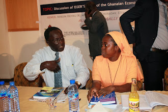 Photo: Sr. Dr. Eugenia Amporfu, Economics Head of Department (KNUST) and Prof. Kwamena Anaman (ISSER) in a conversation