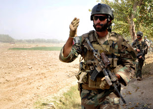 Photo: An United States Special Forces (USSF) soldier give commands to element as USSF and Aghanistan National Army Special Forces soldier patrol in Hyderbad,  Helmand Province, Afghanistan on Oct. 13.  The ANASF spoke to Afghan locals if they can assist with any medical needs and to reassure the local community the ANASF and USSF is there to help in security against the Taliban.  The site is projected to hopefully run a successful Village Stability Operations (VSO) program that one day local Afghans can defend themselves the Taliban.  (Digitally Altered by Staff Sgt. Rasheen A. Douglas/Released)