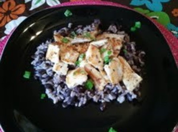 Serve tilapia over rice and top it with chives.  Squeeze more lemon juice...