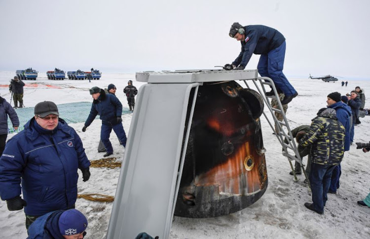 A Search and rescue team works at the landing site of the Soyuz MS-06 space capsule with International Space Station crew members Joe Acaba and Mark Vande Hei of the U.S., and Alexander Misurkin of Russia in a remote area outside the town of Dzhezkazgan (Zhezkazgan), Kazakhstan, on February 28, 2018.