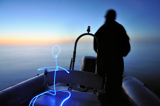 Photo: Fishing above the clouds - Light painting by Christopher Hibbert, french photographer and light painter. Further information: http://www.christopher-hibbert.com