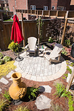 Photo: Sighting a sitting area in a garden instead of beside it makes the landscape more intimate.