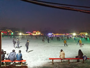 Photo: Watching people skate on Houhai Lake. The first rink we came accross was full of people pushing themselves around the ice on chairs and ice bikes. This rink had some very good skaters, including speed skaters, and hockey players. Way to built up a stereotype, then shatter it.
