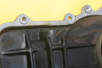 Photo: 1990 Benz 300E2.6 air flow sensor closeup - see crack on idle air port