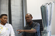 Former Bafana Bafana players and current MTN8 ambassadors Josta Dladla (L) and Jabu Mahlangu at the Tiso Blackstar offices in Parktown, Johannesburg on September 12 2019.