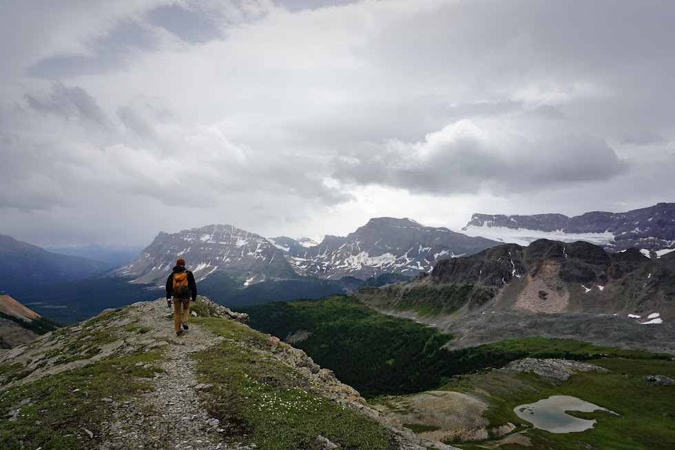 Took a break from cycling to hike into the mountains, and were rewarded with a wintry mix...in August - Banff National Park, Canada