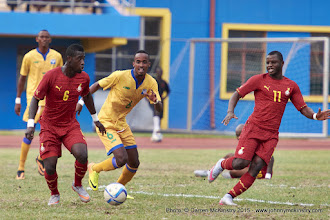 Photo: Affriyea Acqua (6) in space as Yannick Mukunzi (6) moves in. [Rwanda Vs Ghana AFCON2017 Qualifier, 5 Sep 2015 in Kigali, Rwanda.  Photo © Darren McKinstry 2015