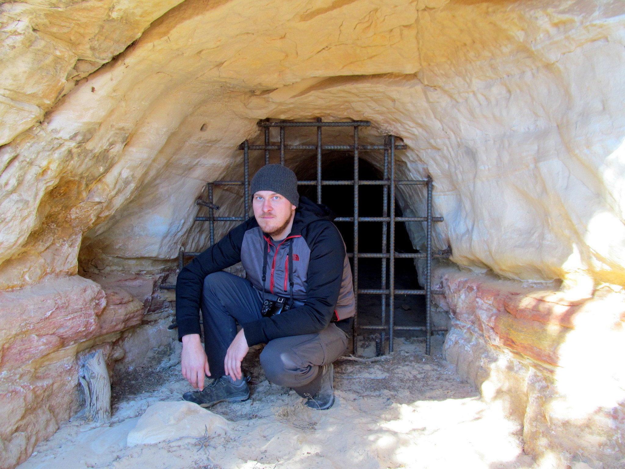 Photo: Chris in front of a closed mine tunnel