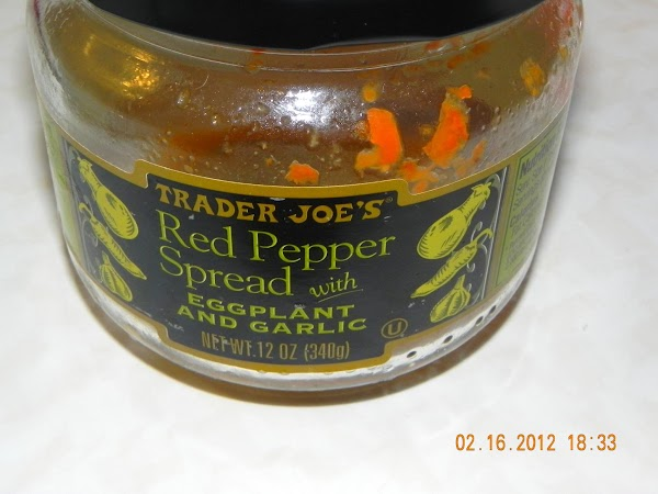 Once chicken is cooked add your entire jar of red pepper spread and cook...