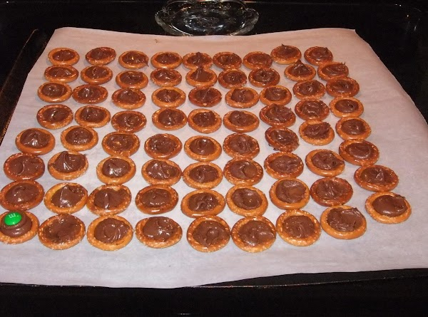 Remove from oven and press chocolate down into pretzel with the back of a...