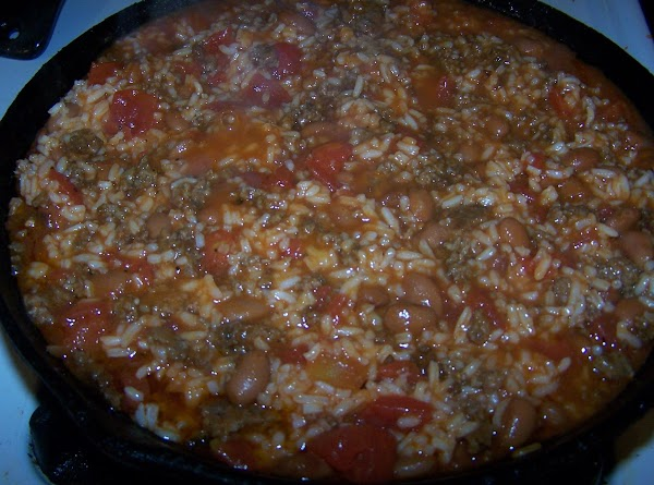 Add two cups (or more) cooked rice to beef mixture. Stir together until well...