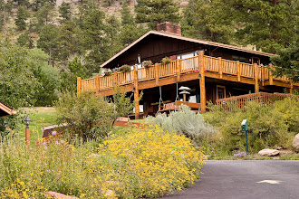 Photo: Chalet building and September flowers.