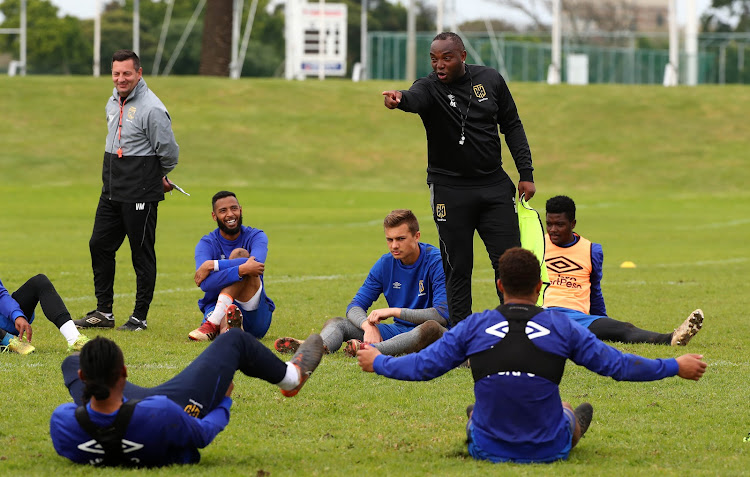Cape Town City FC head coach Benni McCarthy shares a funny moment with his players during a training session and media day at Hartleyvale, Cape Town on August 1 2018.