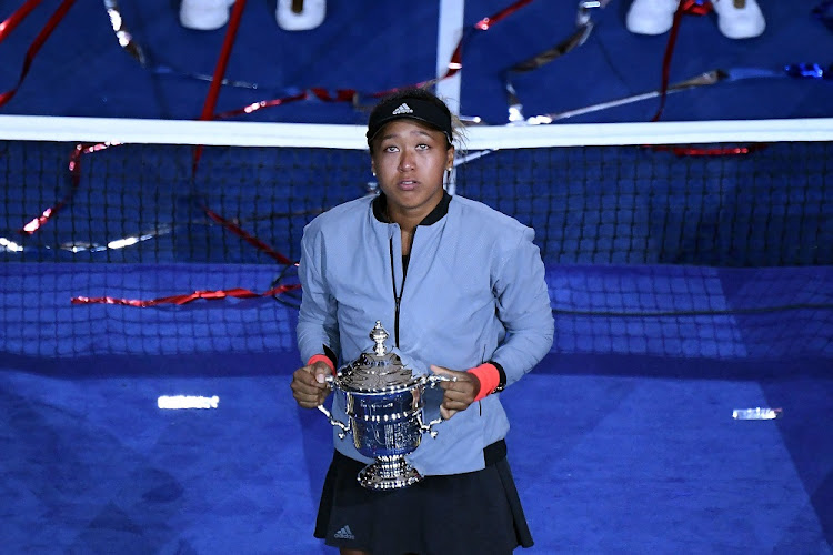 Naomi Osaka of Japan holds the cup after defeating Serena Williams at the 2018 US Open tennis tournament. Picture: DANIELLE PARHIZKARAN/USA TODAY SPORTS