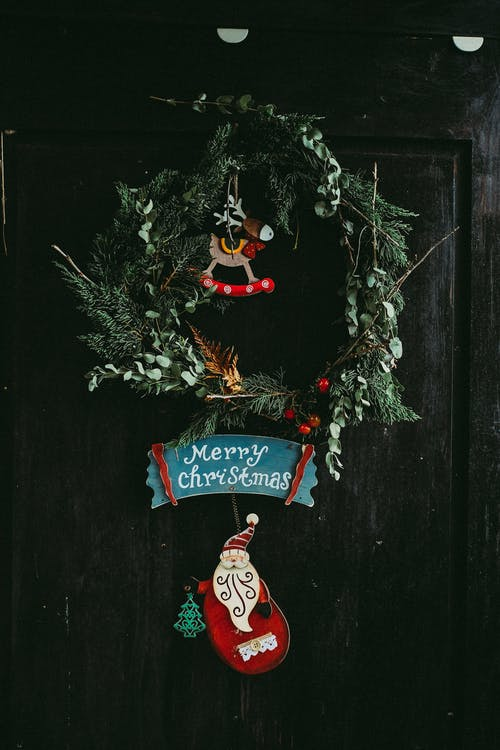 Green Christmas Wreath Hanging on Door