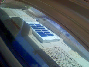 Photo: PV charges a light in the trunk while driving around. Can also charge battery packs or keep a car battery charged when travelling for long periods.