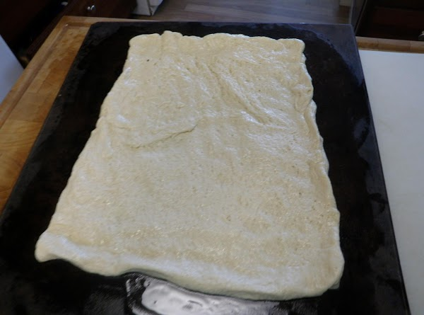 Lightly oil a pizza stone with olive oil and gently press on the dough....
