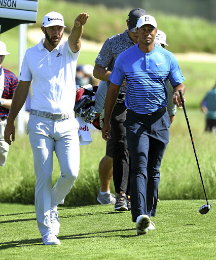 Majors: Dustin Johnson, left, and Tiger Woods get the feel of Shinnecock on Tuesday. Picture: GETTY IMAGES