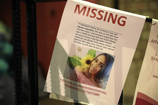 A missing persons leaflet is displayed near a tower block severely damaged by a serious fire, in north Kensington, West London, on June 15 2017. Picture: REUTERS