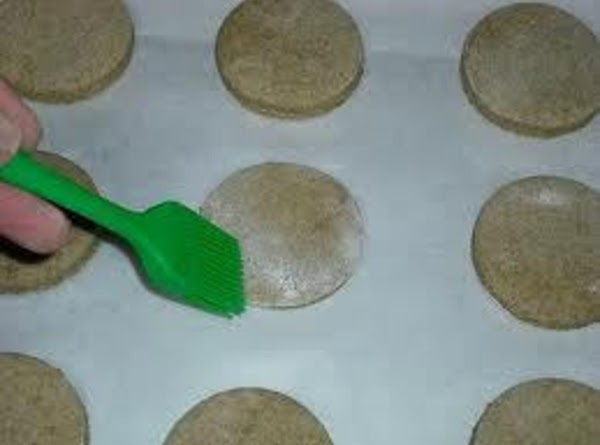 Transfer the cookies to the cookie sheets, brush lightly with a beaten egg and...