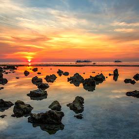 Tranquil by Geoffrey Wols - Landscapes Sunsets & Sunrises ( sunrise, colour, malapascua island, rocks, reflections, sunset, philippines, water,  )