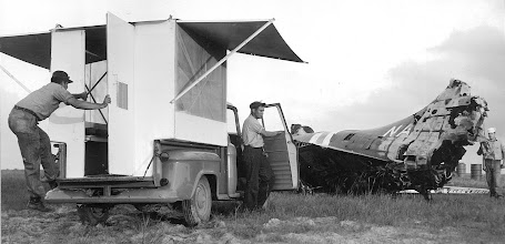 """Photo: At a crash scene the """"Piggy Back"""" guard trailer is opened and ready to provide a cool, bug proof lounge and sleeping quarters"""