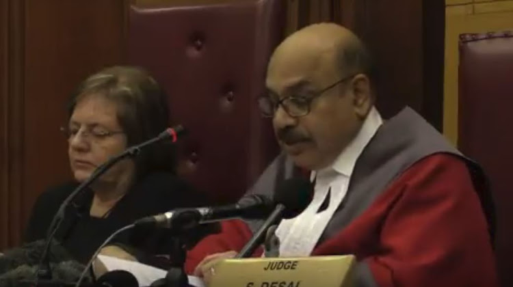 Judge Desai reads the verdict in the Henri Van Breda trial.