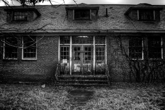 Photo: The Lyman School for Boys was the country's first reform school. Counted among its alumnae is the Boston Strangler. The school was closed in 1971. The high window showing through the entrance gives the appearance someone left a light on. Locals claim the place is haunted.  I've got a few color images in another album. I'll continue to add to it.  #365Project #MonochromeMonday curated by +Siddharth Pandit