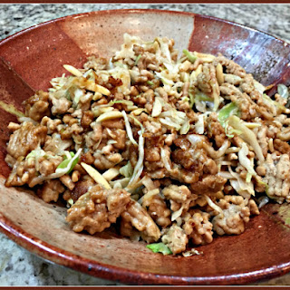 STIR-FRIED CHICKEN AND CABBAGE WITH SPICY ALMOND SAUCE.