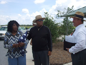 Photo: speaking with the cemetery representative after the honors ceremony