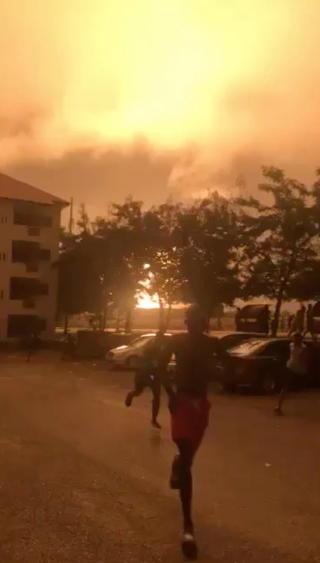 People run after a natural gas station exploded in Ghana's capital Accra, in this still image taken from October 7, 2017 social media video.