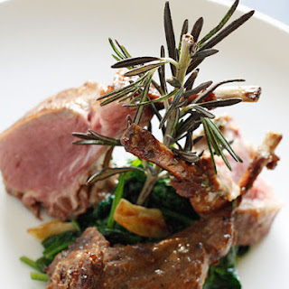 Rack of Lamb with Dijon Glaze over Wilted Baby Spinach.