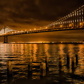 San Francisco Bay Bridge in Lights by Andrew Tolsma - Travel Locations Landmarks ( lights, piers, reflections, show, bridge, san francisco, light )