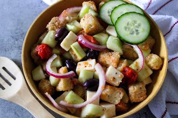 Roasted Grape Tomato Panzanella Salad In A Serving Bowl.