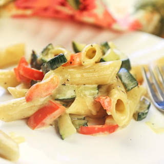 Penne Pasta with Roasted Vegetables in Alfredo Sauce.