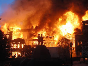 "Photo: A studio set is engulfed in fire at Universal Studios in Los Angeles, Sunday June 1, 2008. A large fire tore through a back lot at Universal Studios early Sunday, destroying a set from ""Back to the Future,"" the King Kong exhibit and thousands of videos and reels in a vault. (AP Photo/Mike Meadows) **MAGS OUT**"