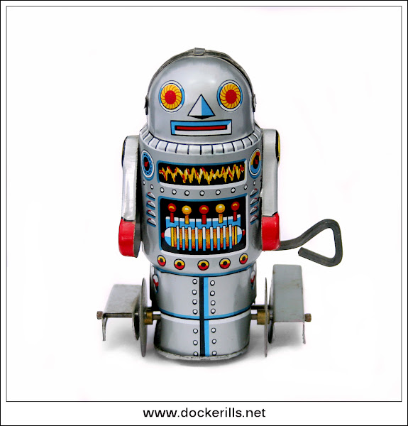 "Photo: Yoneya ""Robot-7"", Japan. (Picture 1 of 2) See also Noguchi.  Tinplate / W/U / Fixed key. Paddle foot robot.  Visit my blog - Collecting Tin Toys at  http://tinplatetoys.blogspot.co.uk/"