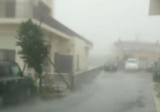 Strong wind and rain are brought by Typhoon Talim in Miyakojima, Japan September 13, 2017 in this still grab taken from a social media video footage from outside Hotel Rising Sun.